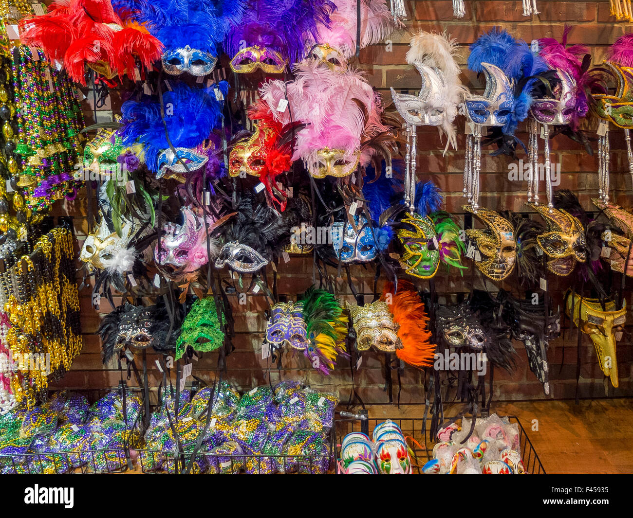 Colorful Mardi Gras masks decorated with feathers are on display in a New Orleans shop. - Stock Image