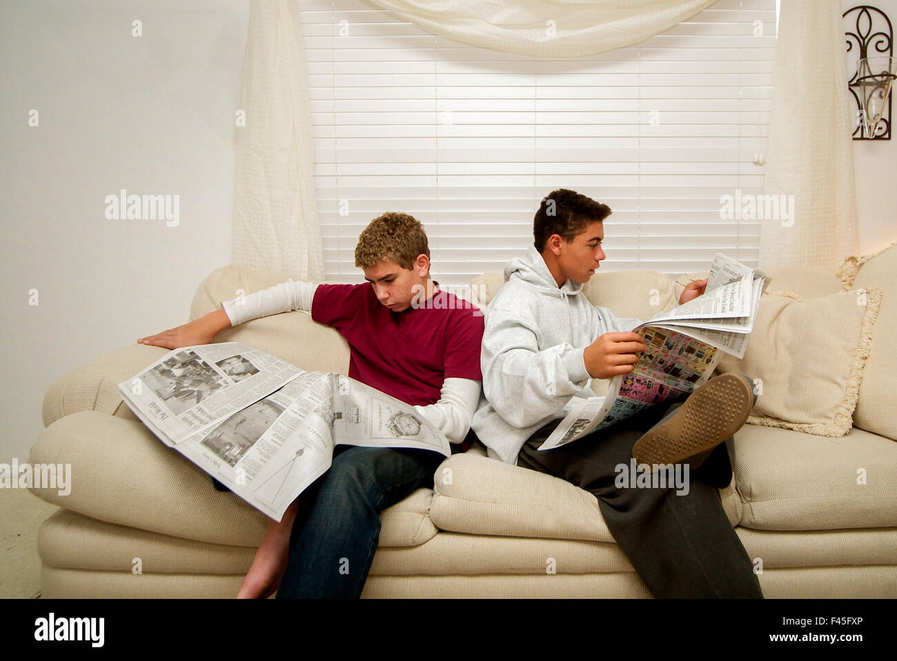 Two teens in sofa