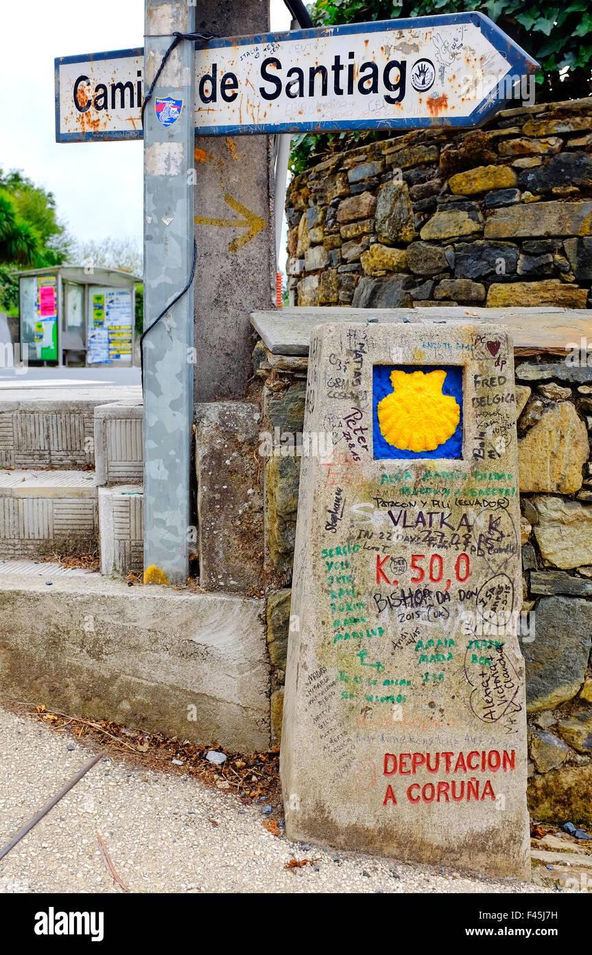 Milestone that marks the last 50 km to Santiago de Compostela in Barrio de Santa Maria de Melide,Galicia, Spain - Stock Image