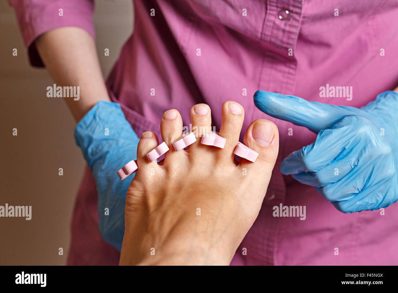 Master chiropody rubbing alcohol, fingernails polish before applying