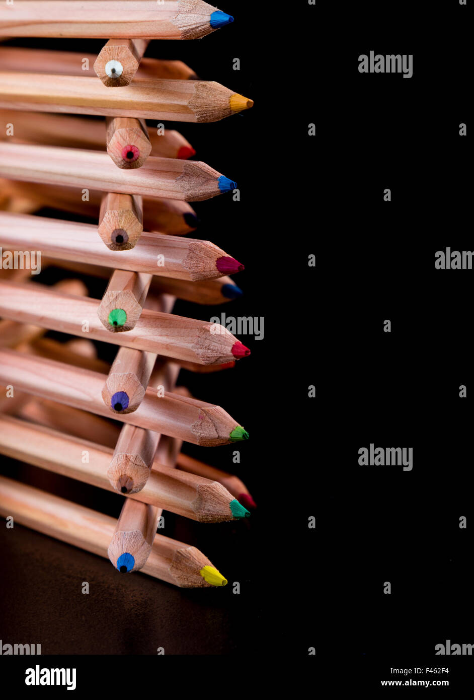 creatively stacked color pencils - Stock Image