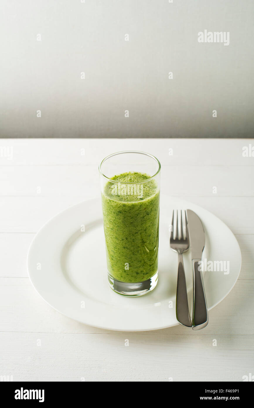 Glass of Healthy green smoothie with vegetables. Stock Photo