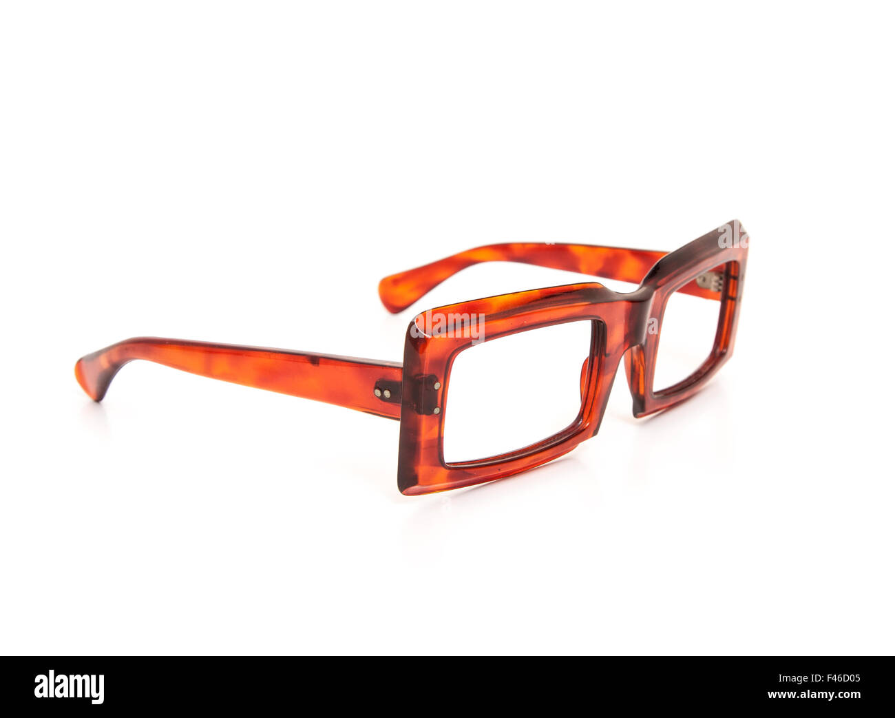 Old fashioned horn-rimmed specs. All on white background. - Stock Image