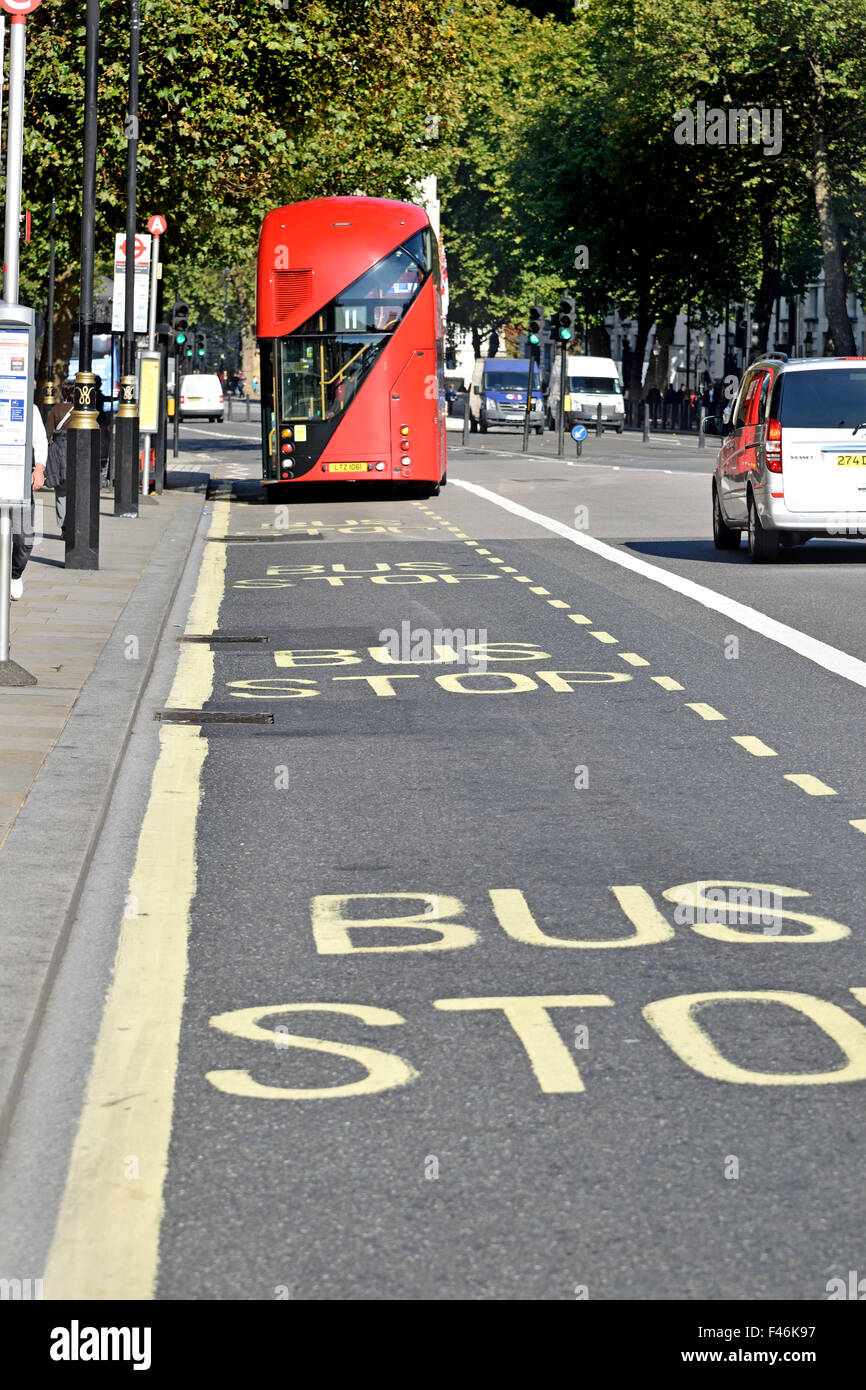 London, England, UK. New Routemaster double decker bus at a bus stop in Whitehall - Stock Image