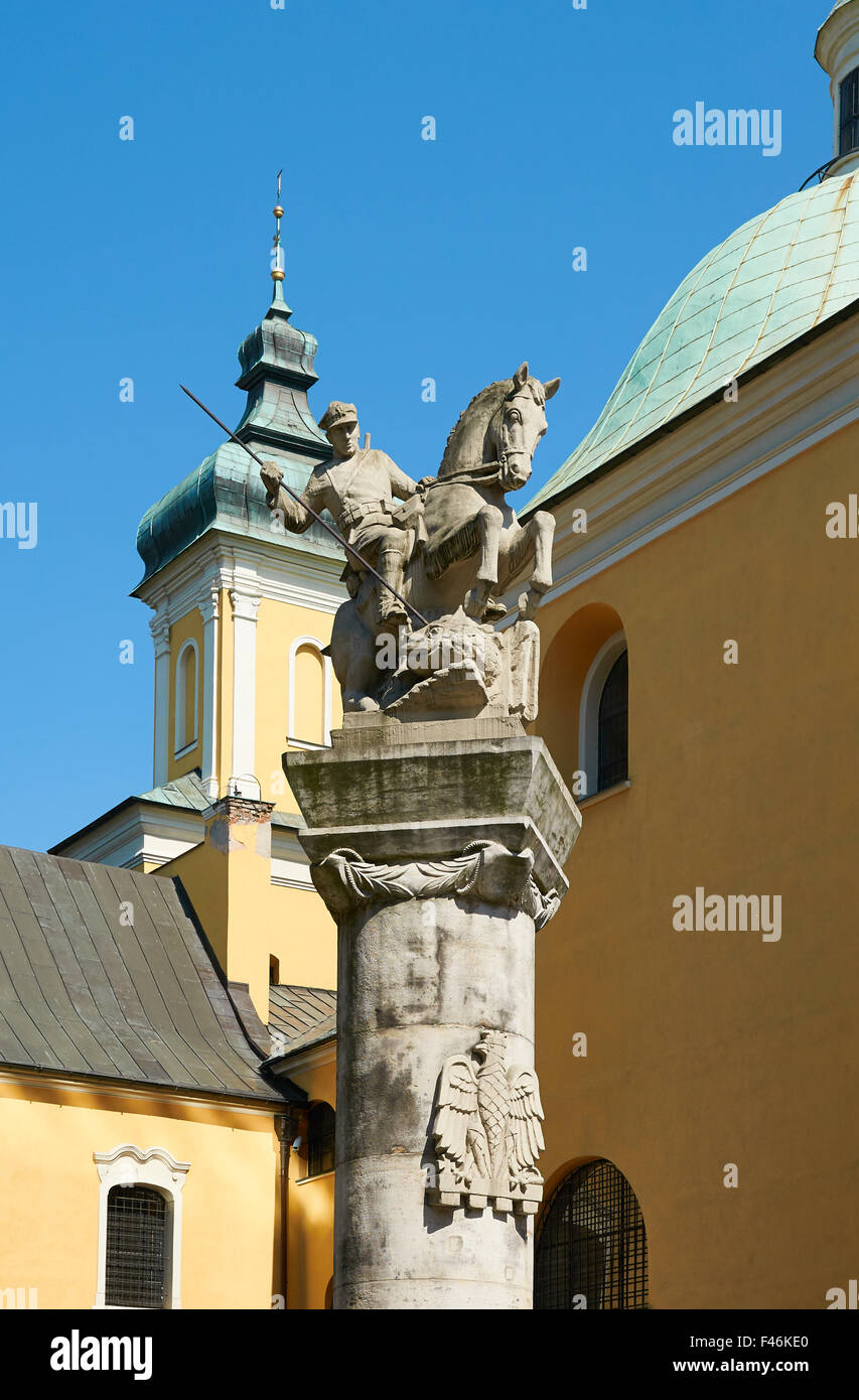 POZNAN, POLAND - AUGUST 20, 2015: A memorial statue to Poznan's Cavalry, shows a soldier on horseback armed - Stock Image