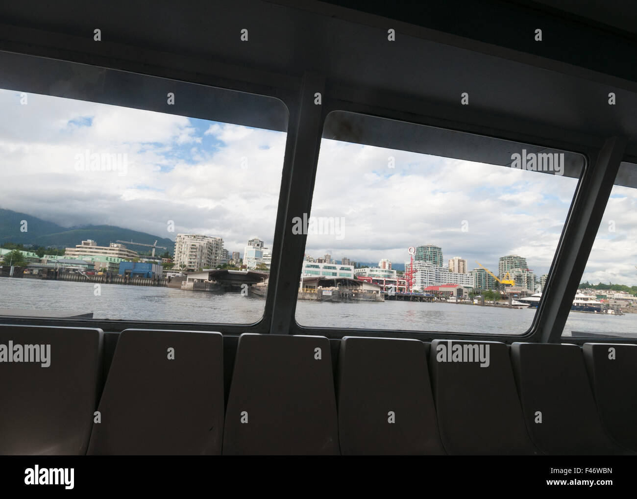 View from SeaBus crossing the Burrard Inlet and approaching Lonsdale Quay terminal, North Shore, Vancouver, Canada - Stock Image