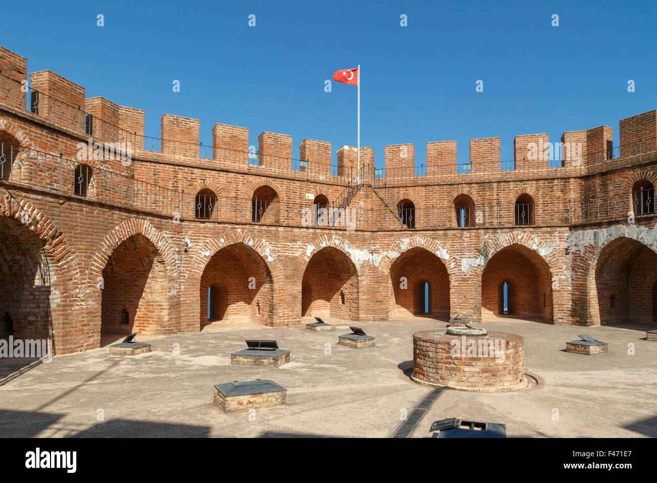 View of Alanya Red Tower in Antalya  with orenge bricks, on bright blue sky background. - Stock Image