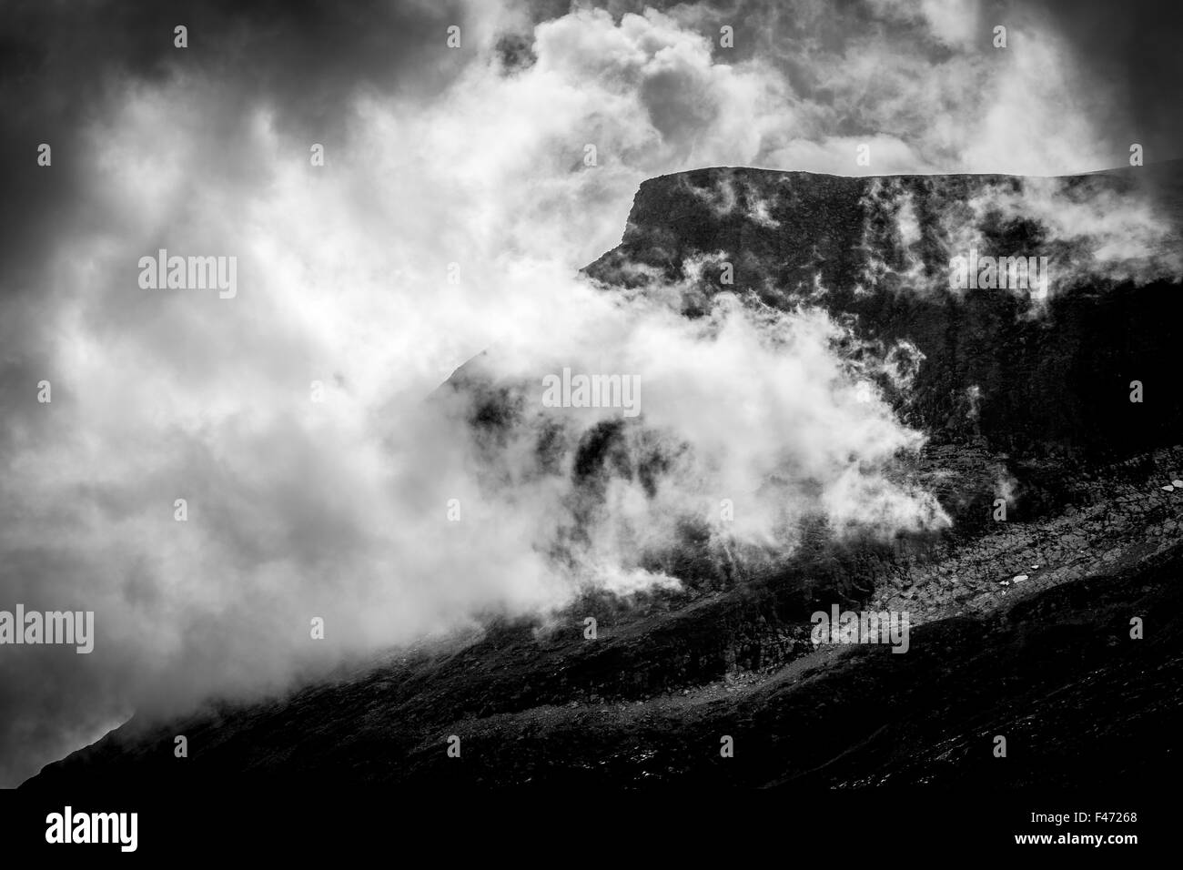 A mountain with clouds in Norway - Stock Image