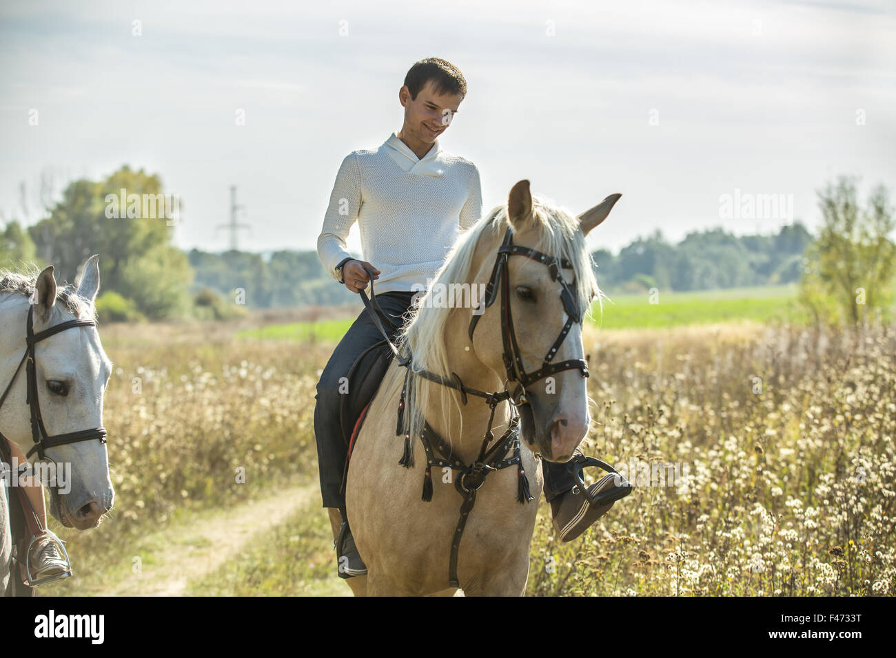 Attractive man on horseback - Stock Image