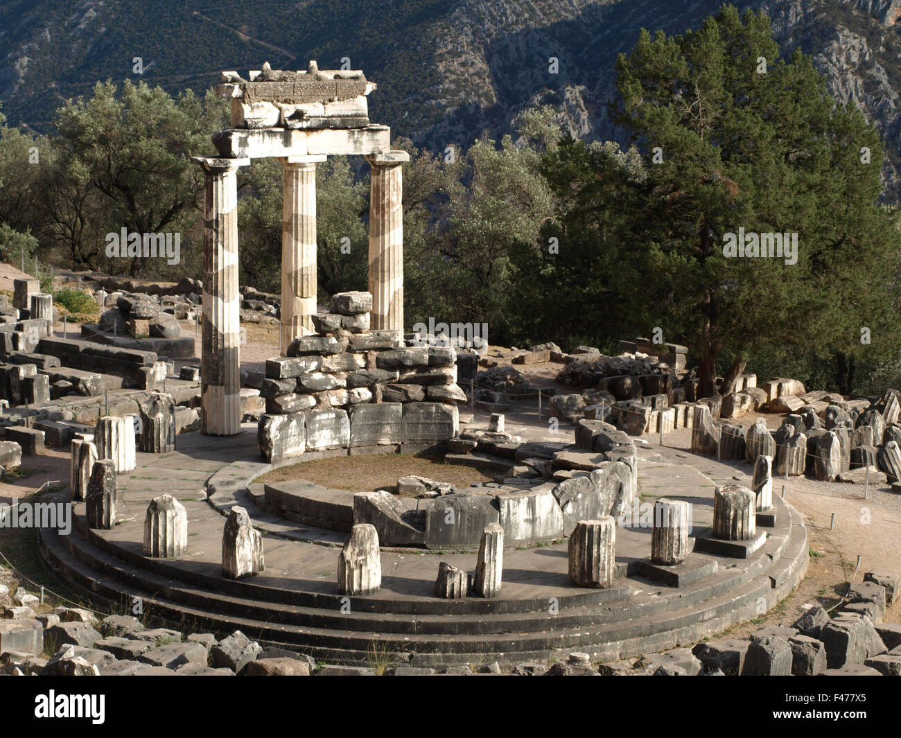 5804. The sanctuary of Athena Pronaia in Delphi. The  circular building is called 'Tholos' was built in c. 380 BC. Stock Photo