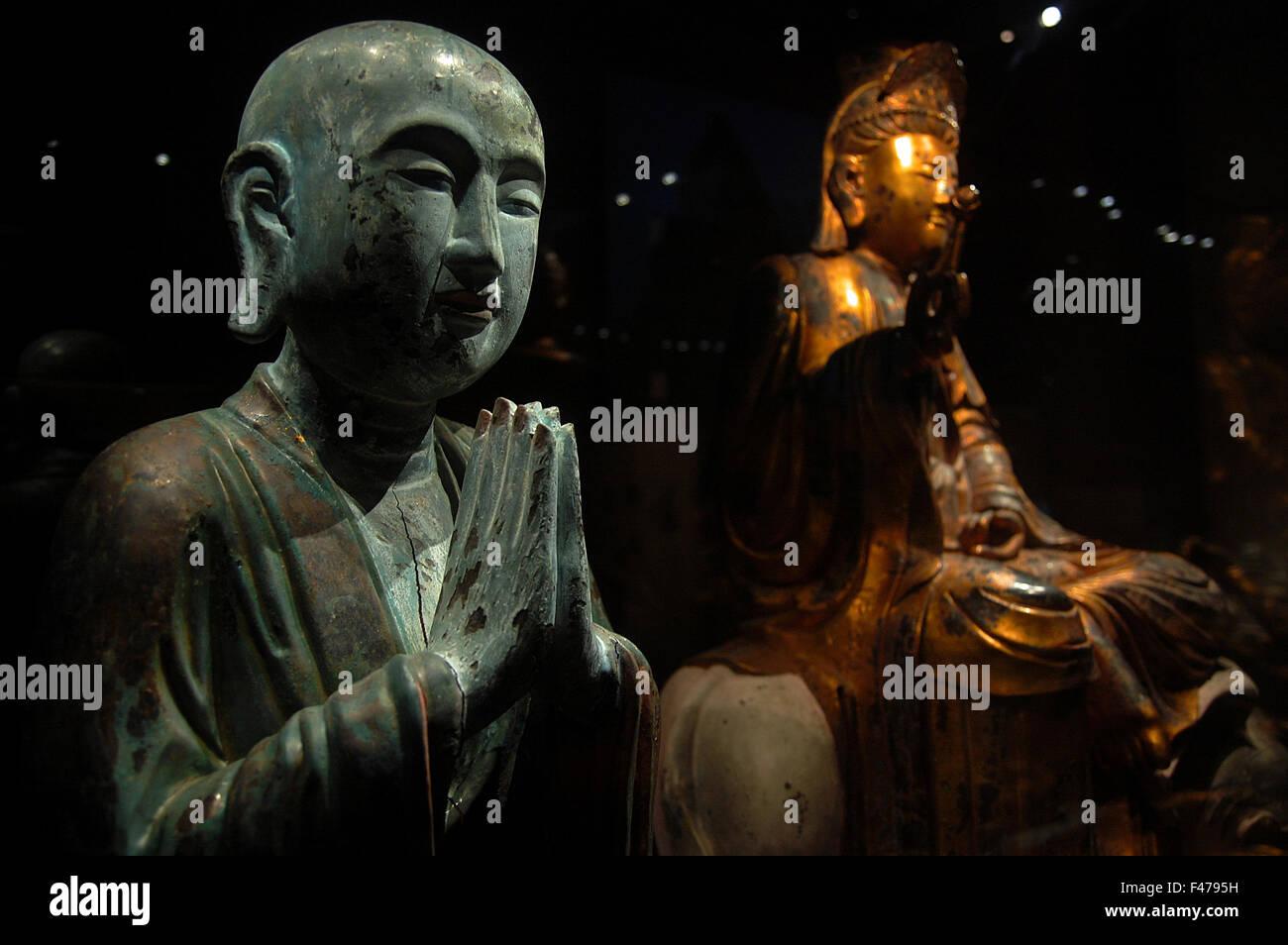 Bronze figure of Buddha praying at the Asian Civilisations Museum in Singapore - Stock Image