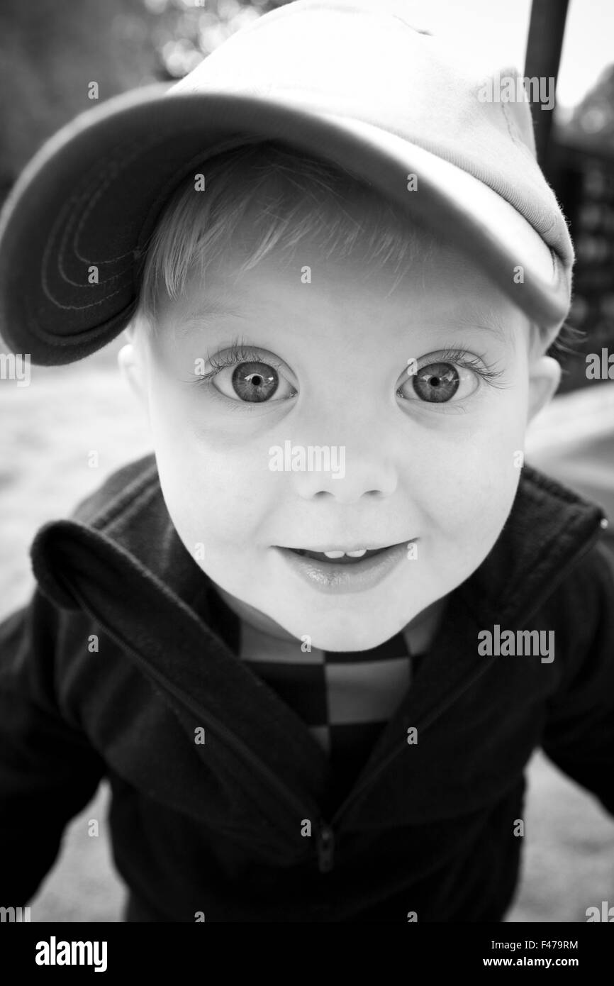 Portrait of a little boy with his eyes wide open, Sweden. - Stock Image