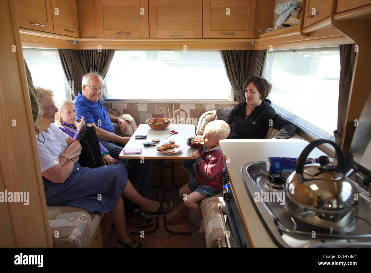 English family enjoying their leisure time whilst on holiday together in a caravan, England, UK - Stock Image