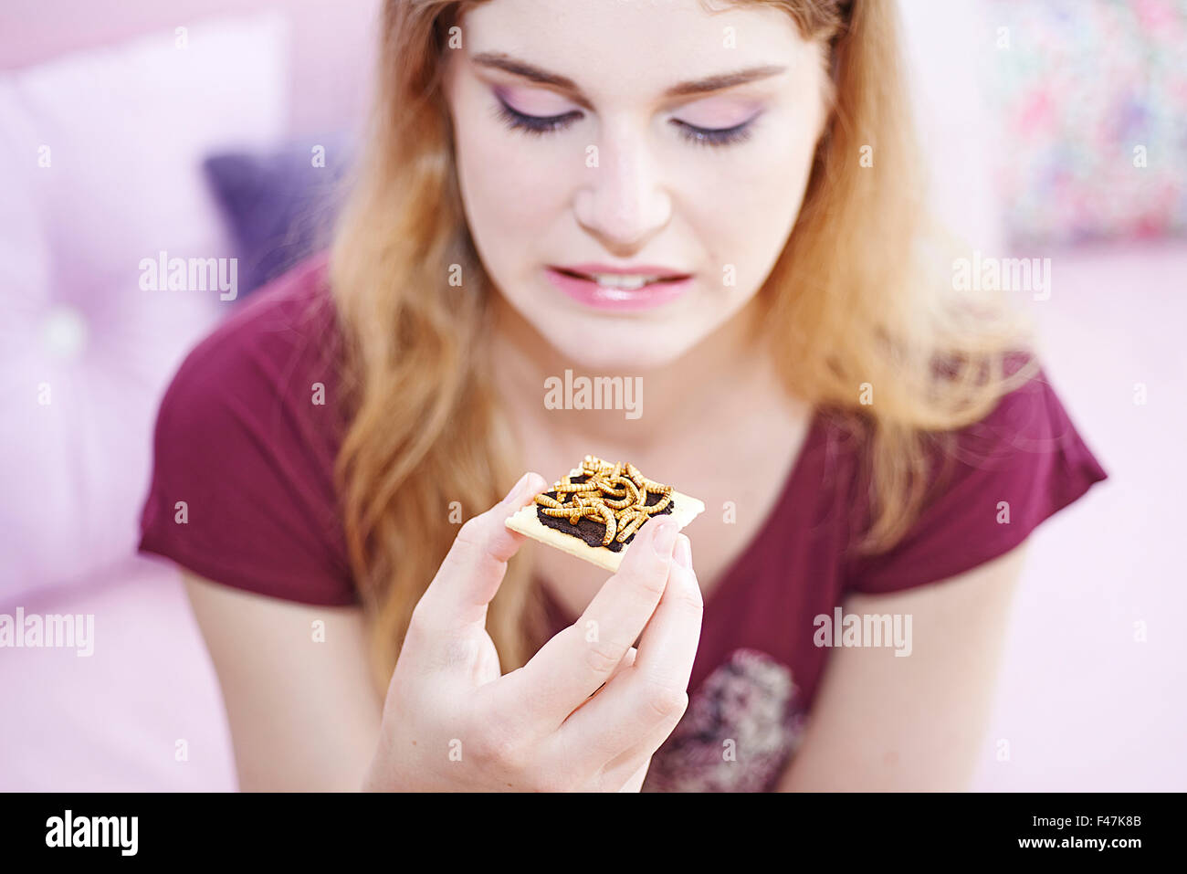 WOMAN EATING INSECT - Stock Image