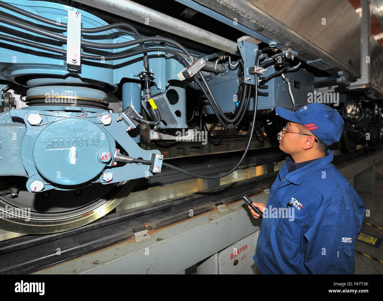 Changchun, China's Jilin Province. 15th Oct, 2015. Workers tie up loose end of the autopilot subway train for the Stock Photo