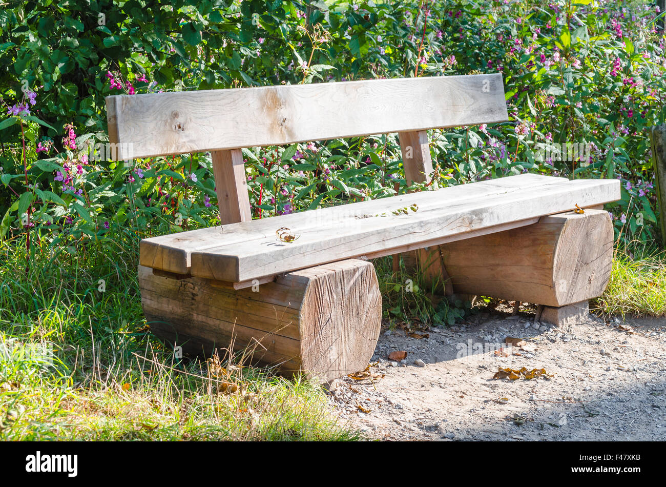 Bench, park bench made of tree trunk Stock Photo