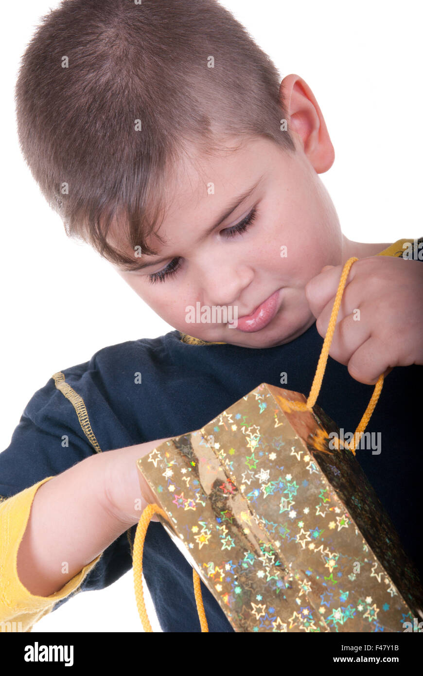 Boy searches for a gift - Stock Image