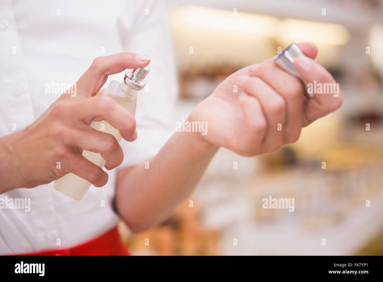 Pretty blonde trying a perfume - Stock Image