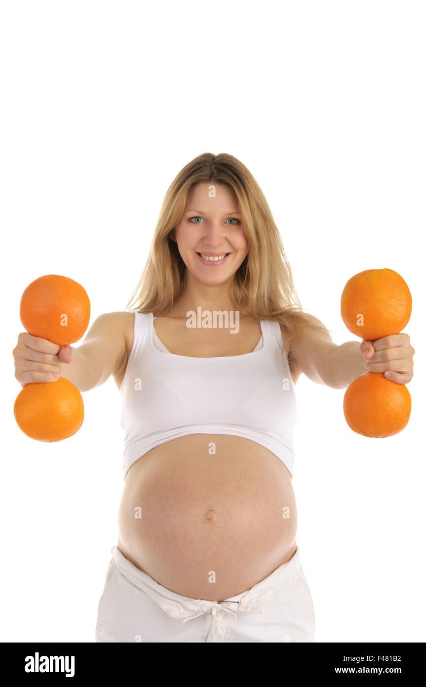 pregnant women involved in fitness oranges - Stock Image