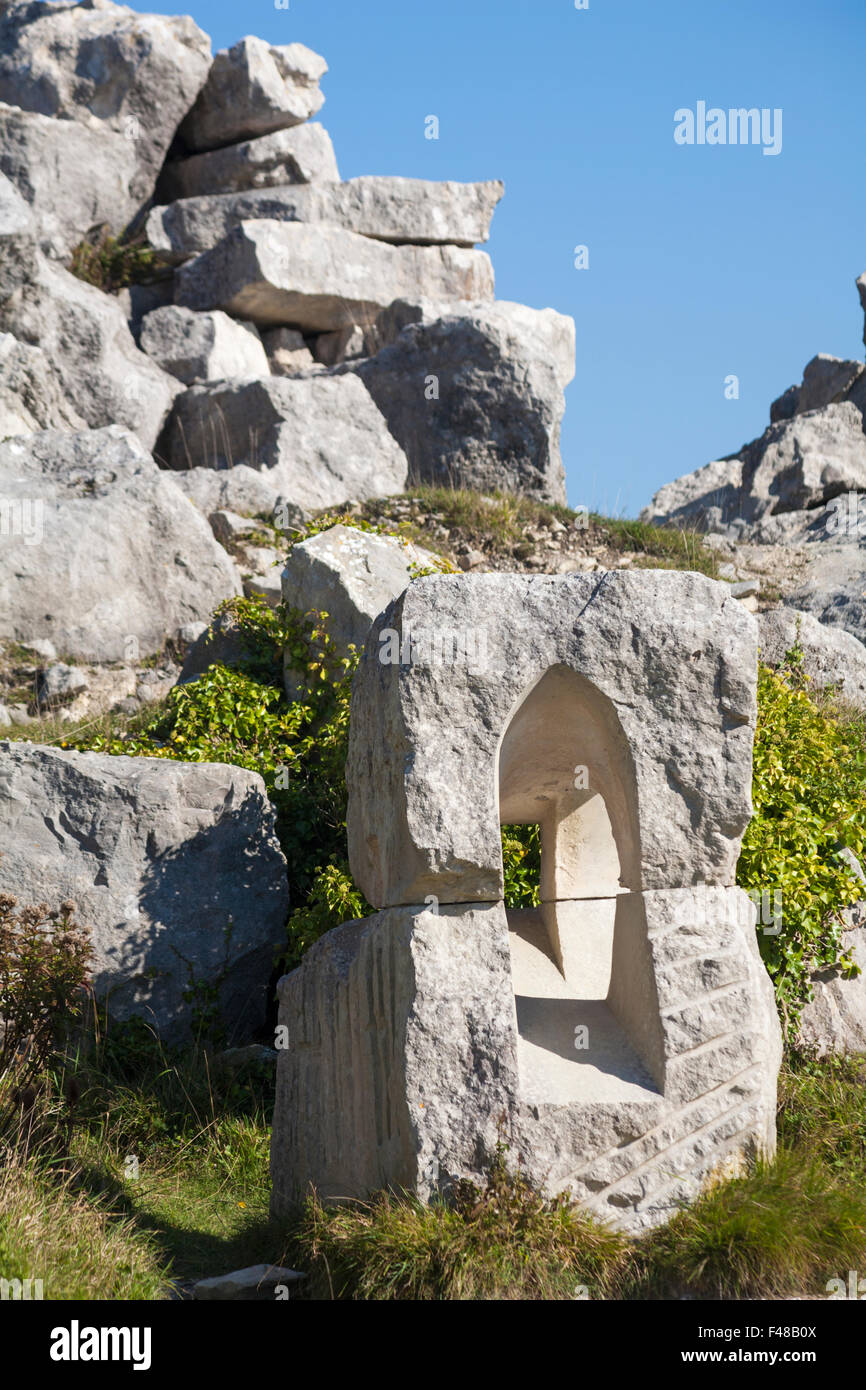 Window stone sculpture by Justin Nicol at Tout Quarry, Isle of Portland in October - Stock Image