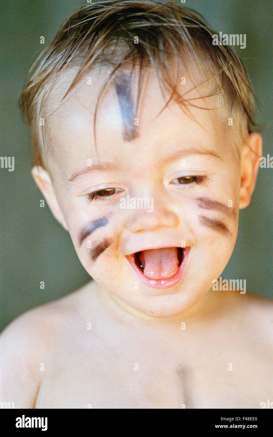 A little boy with a painted face, Sweden. - Stock Image