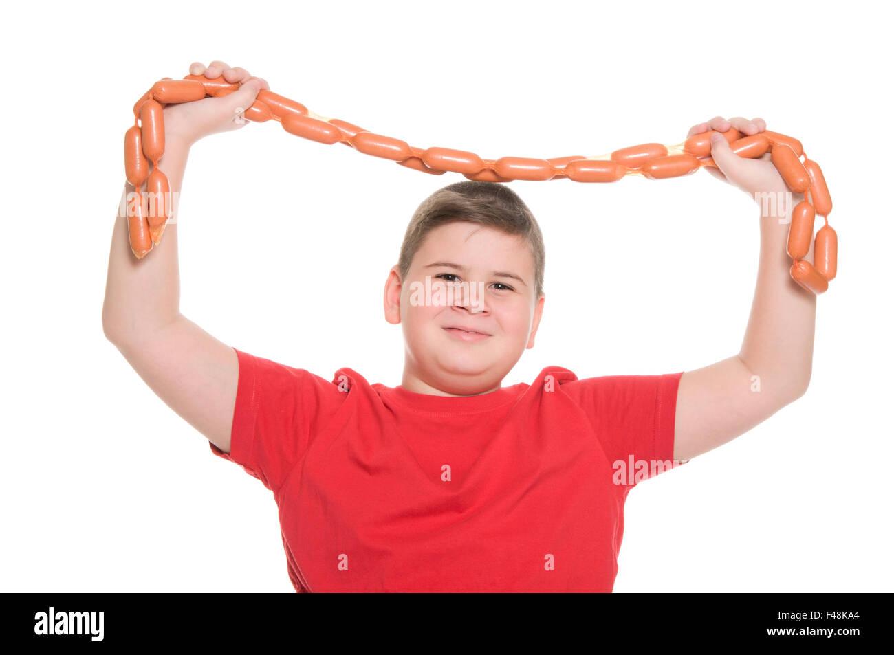 chubby boy with sausage Stock Photo