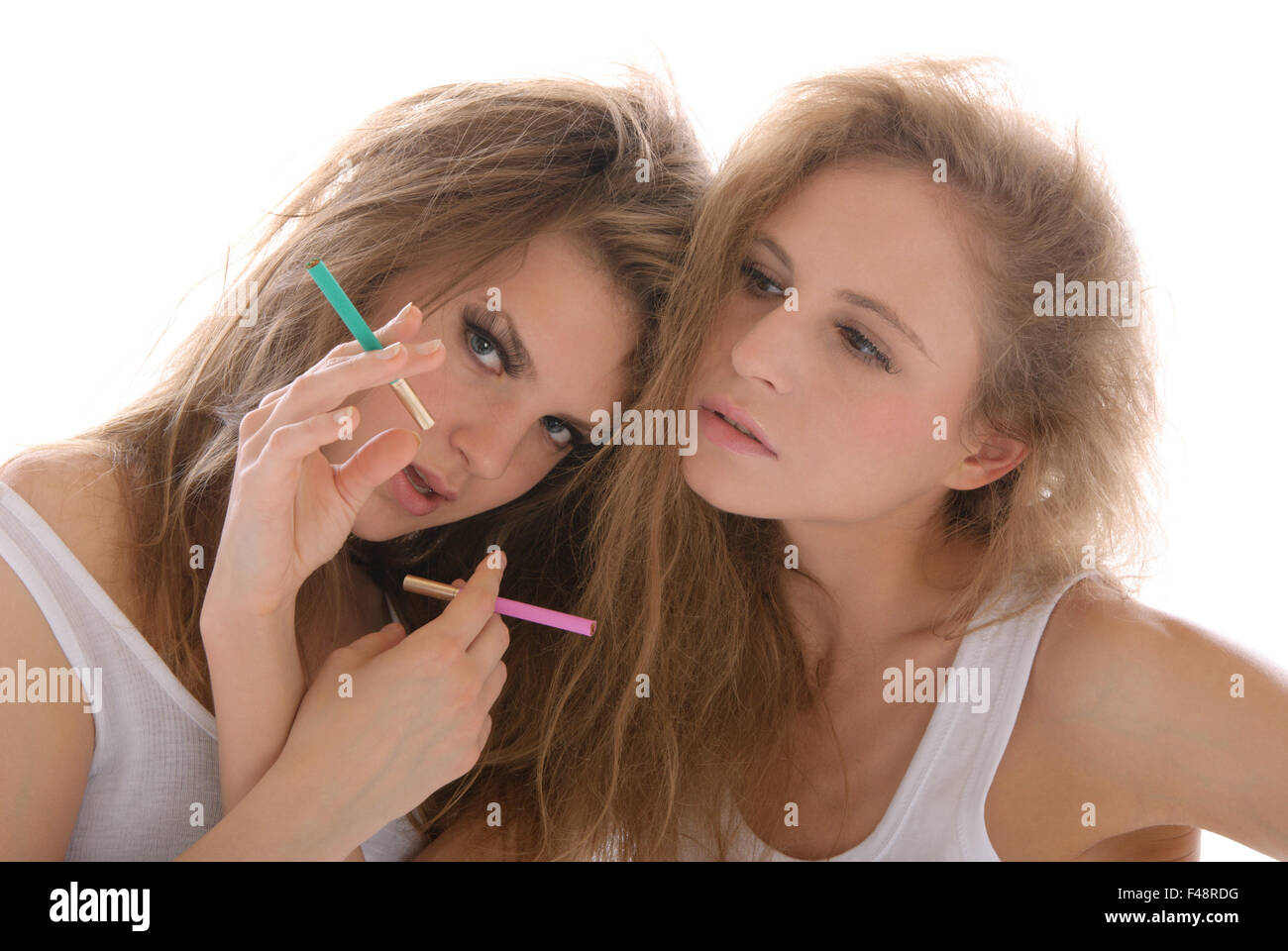 Two young women with cigarettes - Stock Image