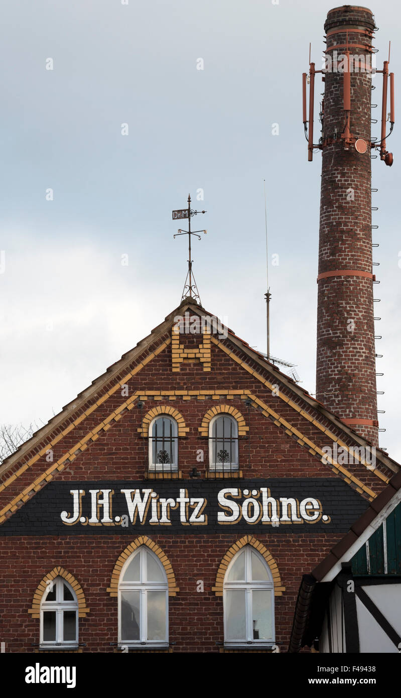Historic J.H. Wirtz Sohne factory now residential housing with telecommunications masts fitted to the chimney - Stock Image
