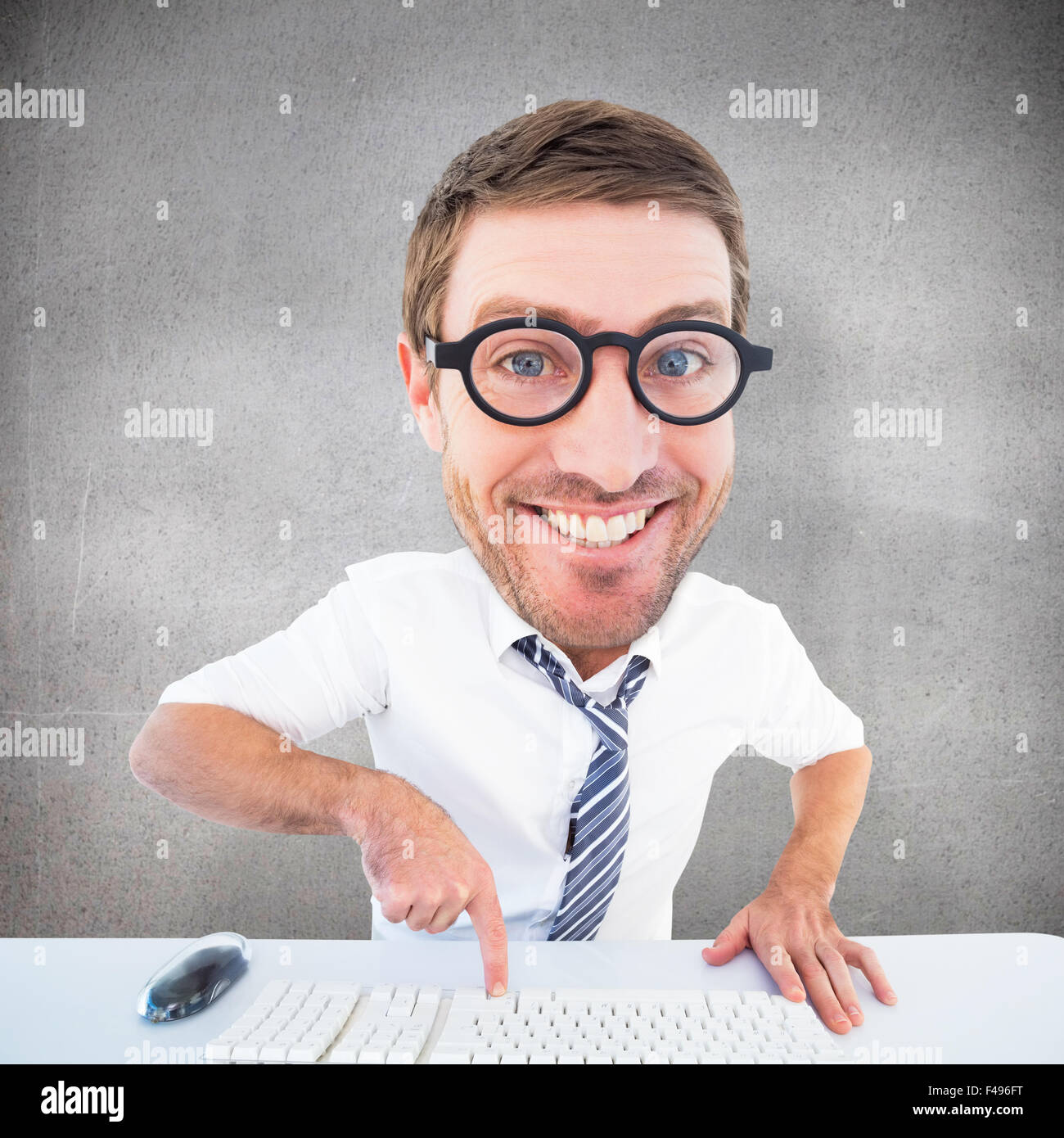 Composite image of geeky businessman typing - Stock Image