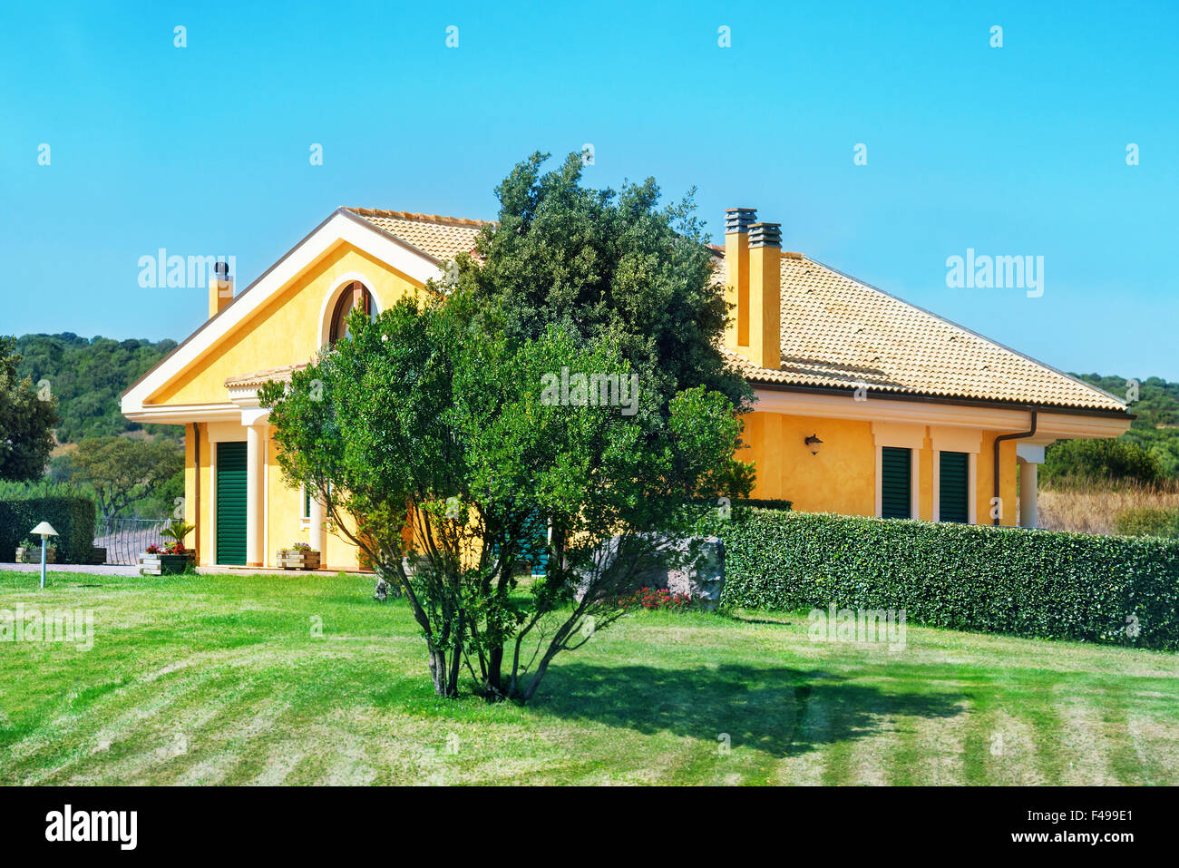 Cozy house with garden - Stock Image
