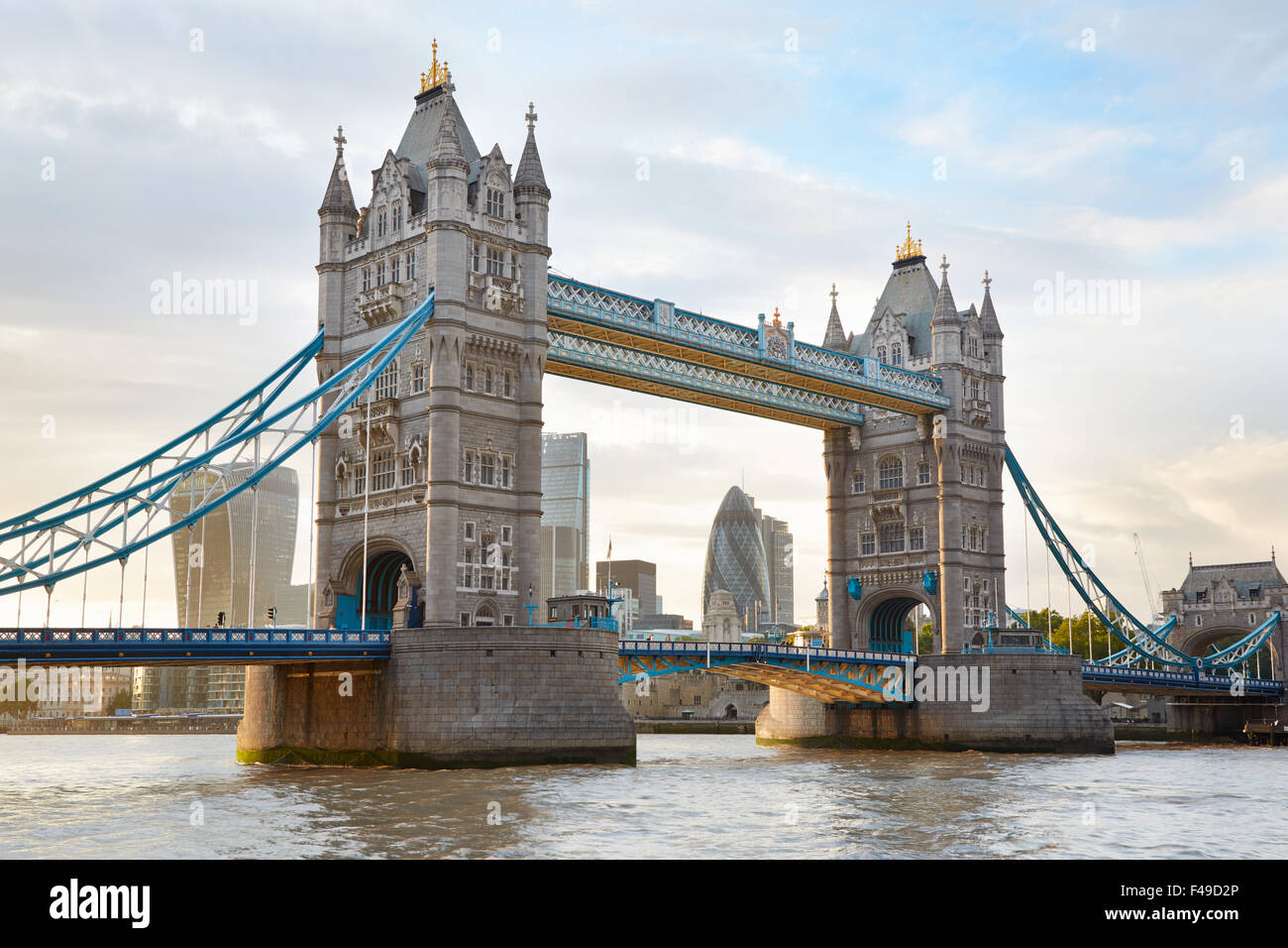 Tower bridge in London in the afternoon sunlight with skyscrapers view - Stock Image