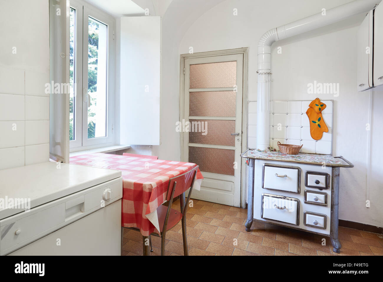 Old kitchen with stove in normal interior - Stock Image