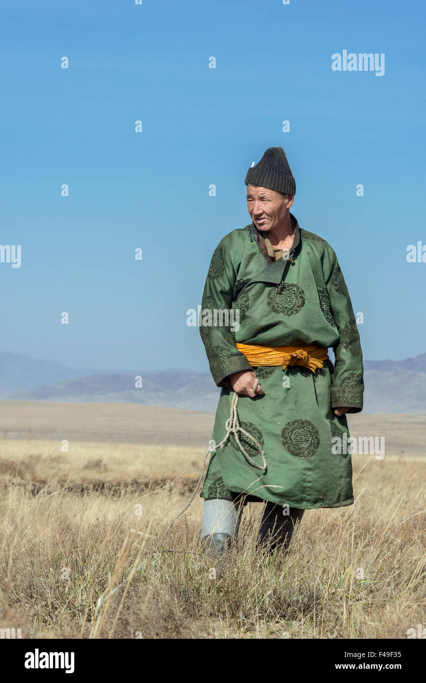 Portrait of a Mongolian goat herder on the steppes, near Hustai National Park, Mongolia - Stock Image