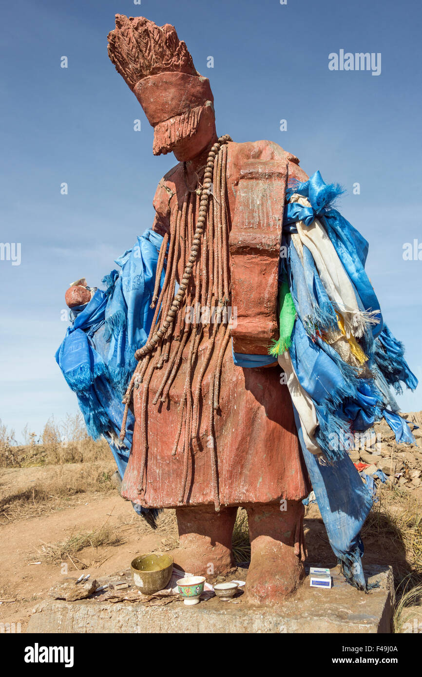 Mongolian Tengrism shaman statue with blue silk prayer scarves, near Hustai National Park, Mongolia - Stock Image