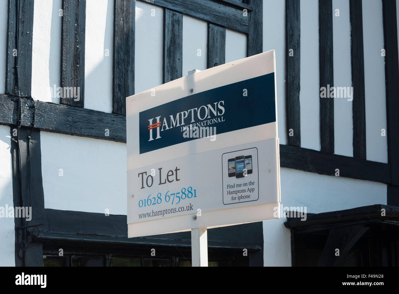 Hamptons International 'To Let' sign outside house, The Street, Waltham St Lawrence, Berkshire, England, - Stock Image