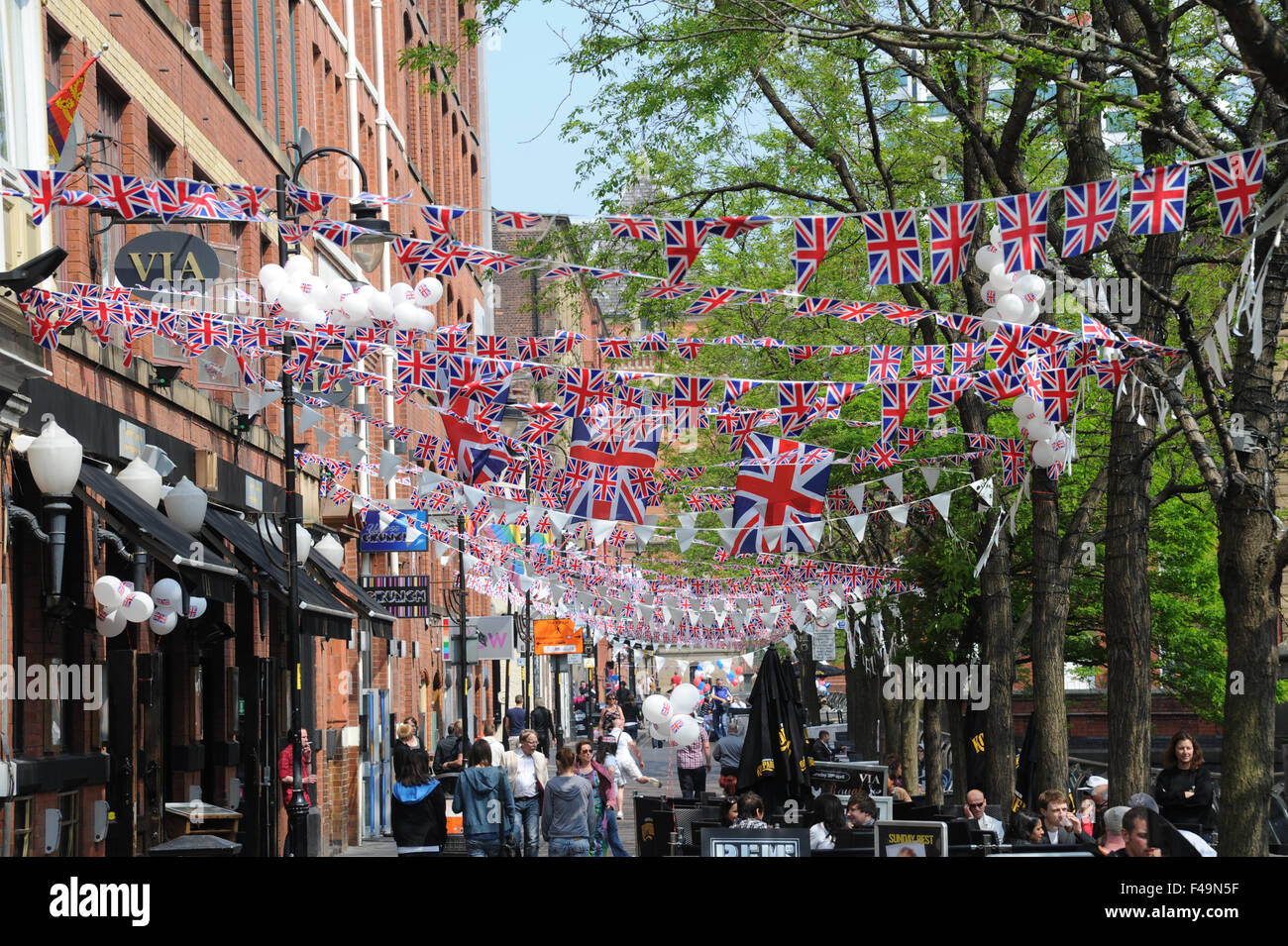 Party bunting on Canal Street in the heart of Manchester's Gay village to celebrate the wedding of William and - Stock Image