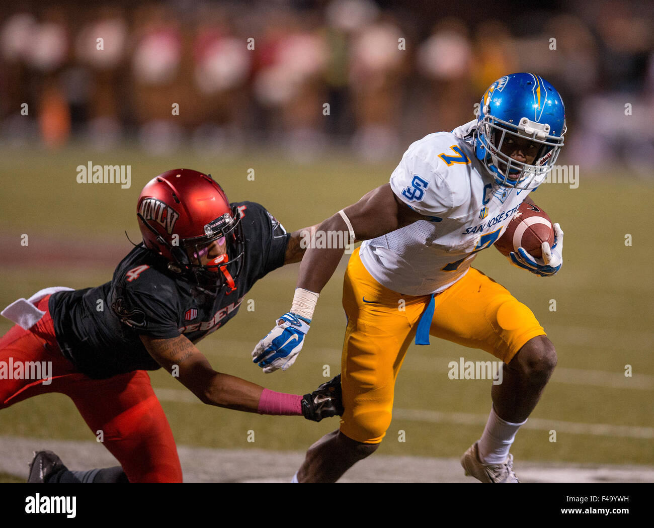 Las Vegas, NV, USA. 10th Oct, 2015. San Jose State running back (7) Tyler Ervin tries to break free of an attempted Stock Photo