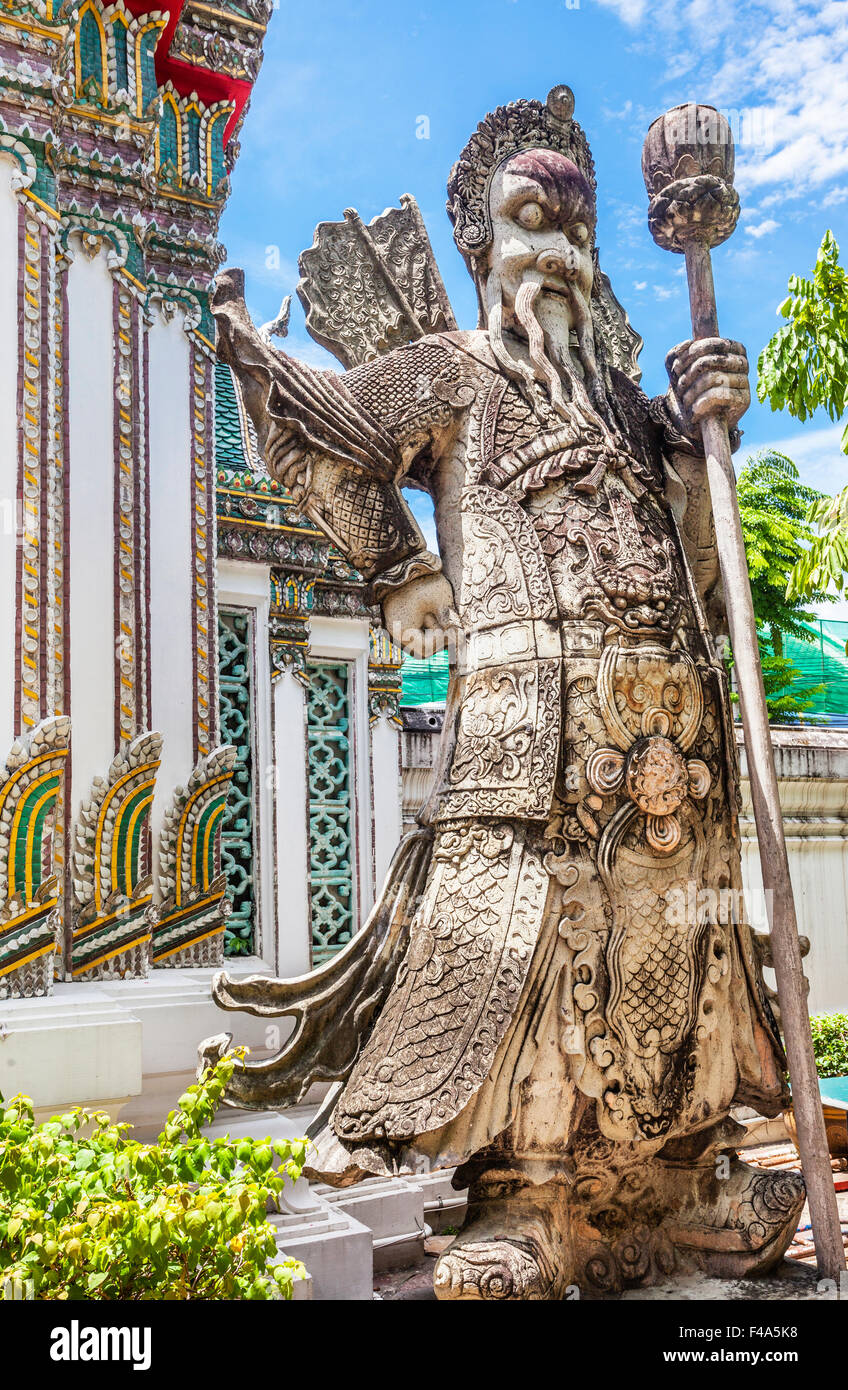 Thailand, Bangkok, Wat Po, warrier statue guarding the buddhist temple - Stock Image