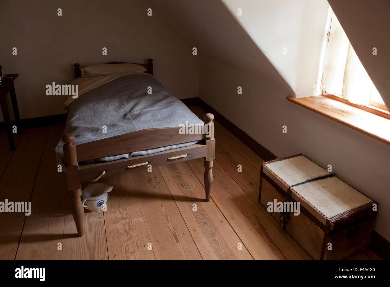 Bed in 18th century style loft bedroom - Alexandria, Virginia USA - Stock Image