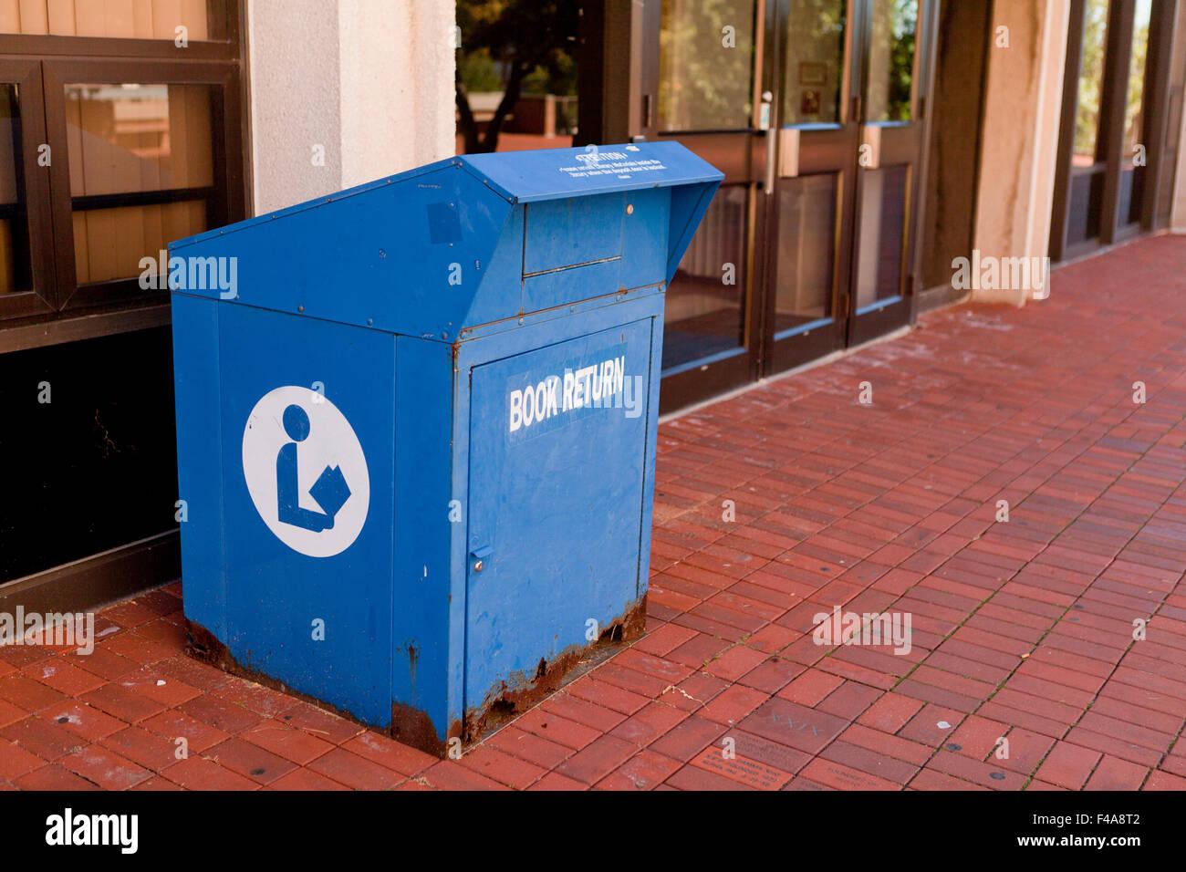 Book return box at library exterior - USA - Stock Image
