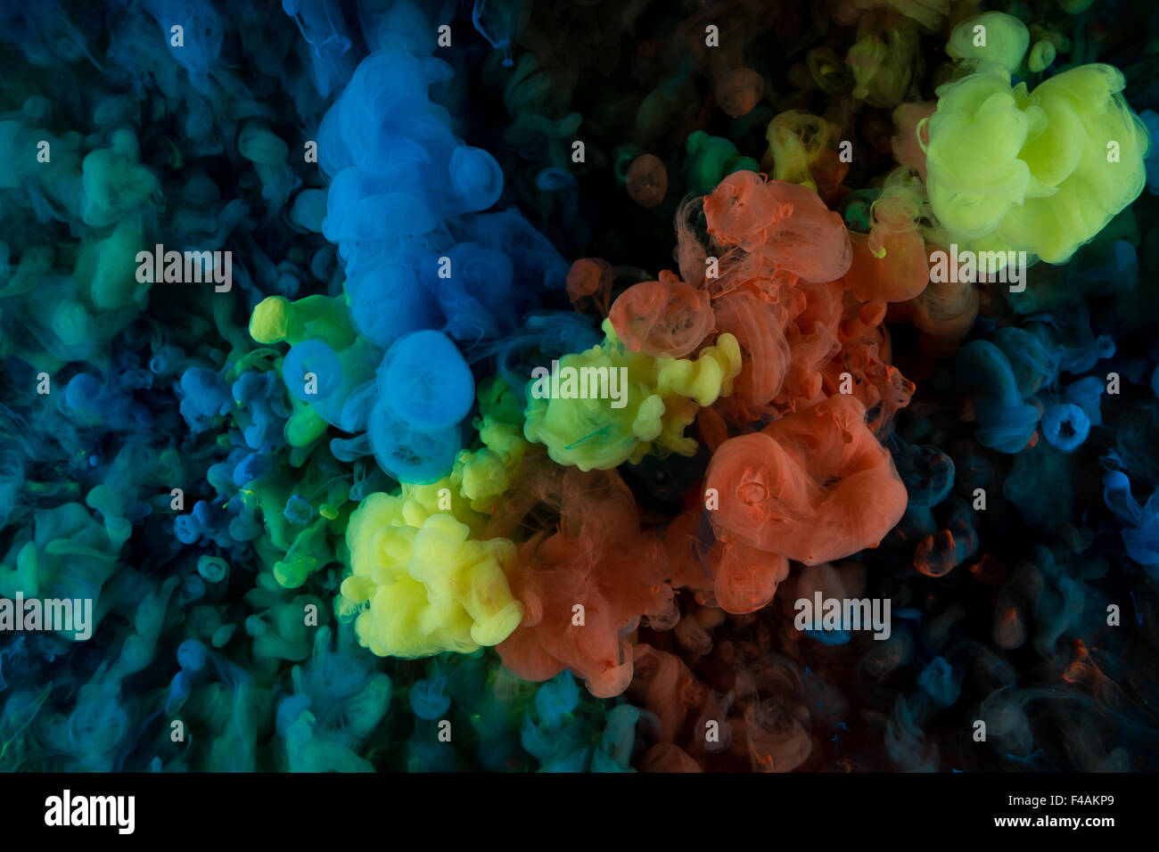 color paint in water, shot from below - Stock Image