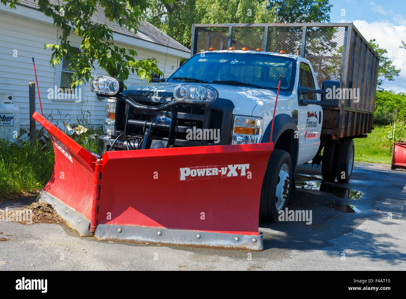 Ford pickup truck with snow plow attached - Stock Image