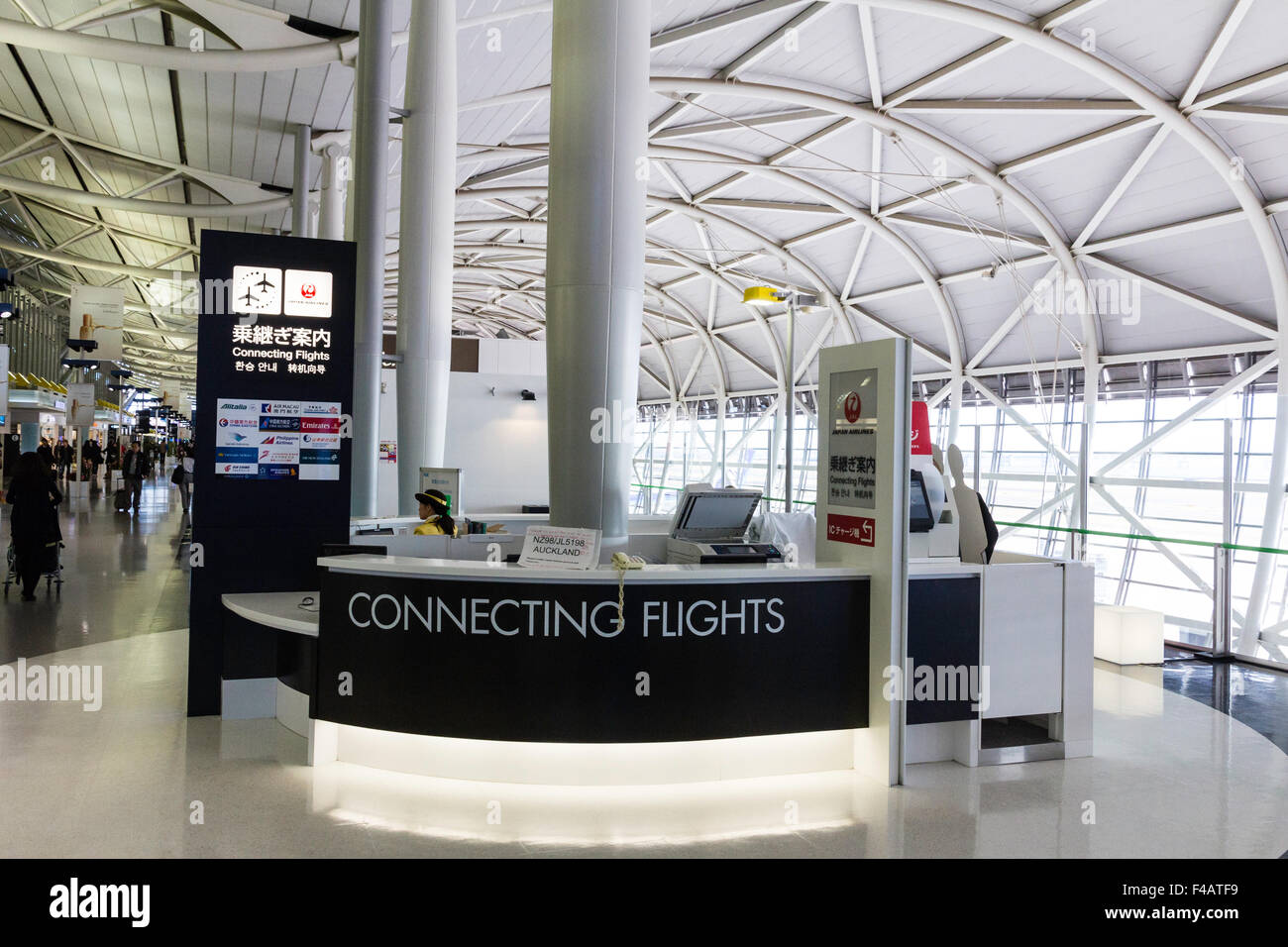 Interior of Kansai Airport, Osaka, Japan, in the International Departures lounge. Connecting flight desk in departure - Stock Image