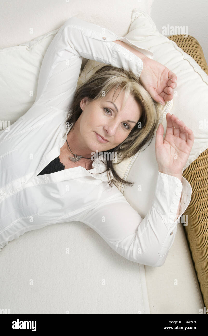 lying comfy on the couch - Stock Image
