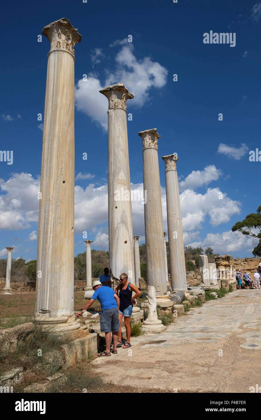 Vertical view of tourists inspecting Corinthian Columns at the ancient Roman site of Salamis, Famagusta  Northern - Stock Image