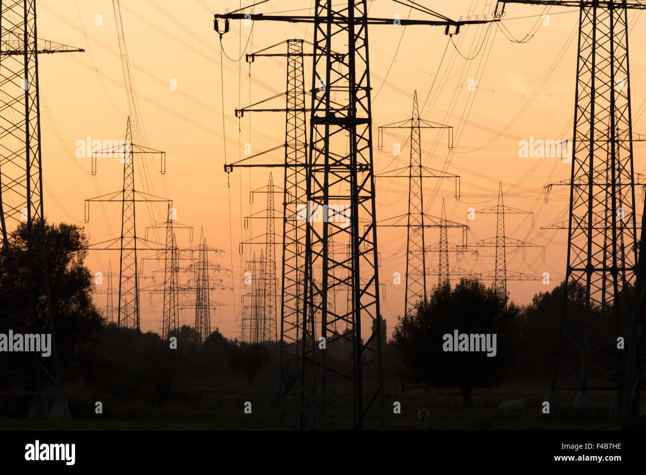 Overhead cables in a sundown landscape 4 - Stock Image