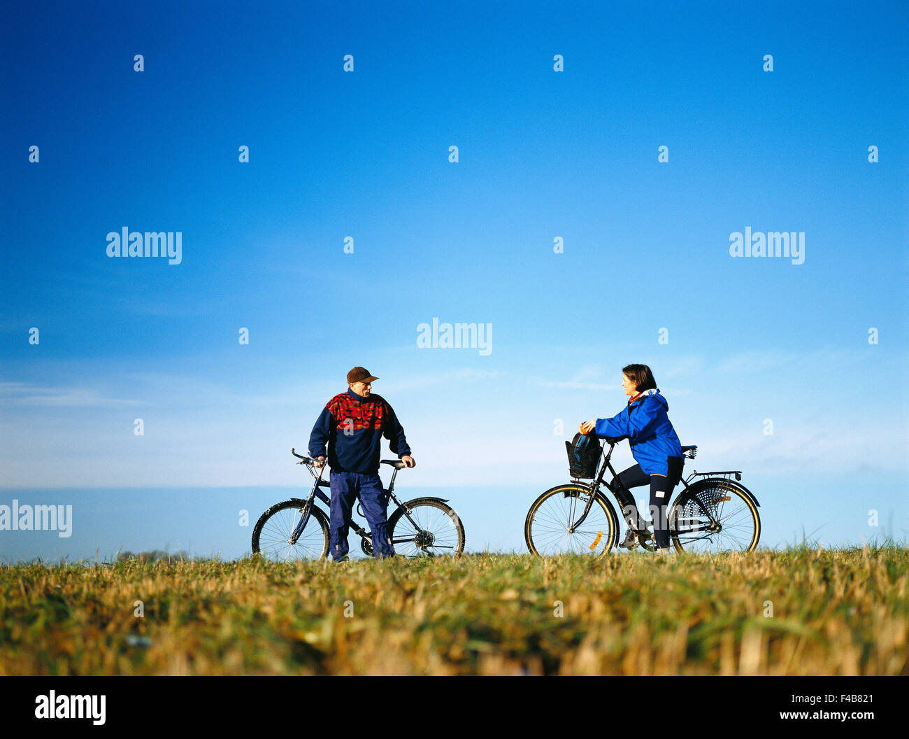 35-39 years 45-49 years activity adults only autumn blue casual clothing catalogue 2 clear sky color image cultivated - Stock Image