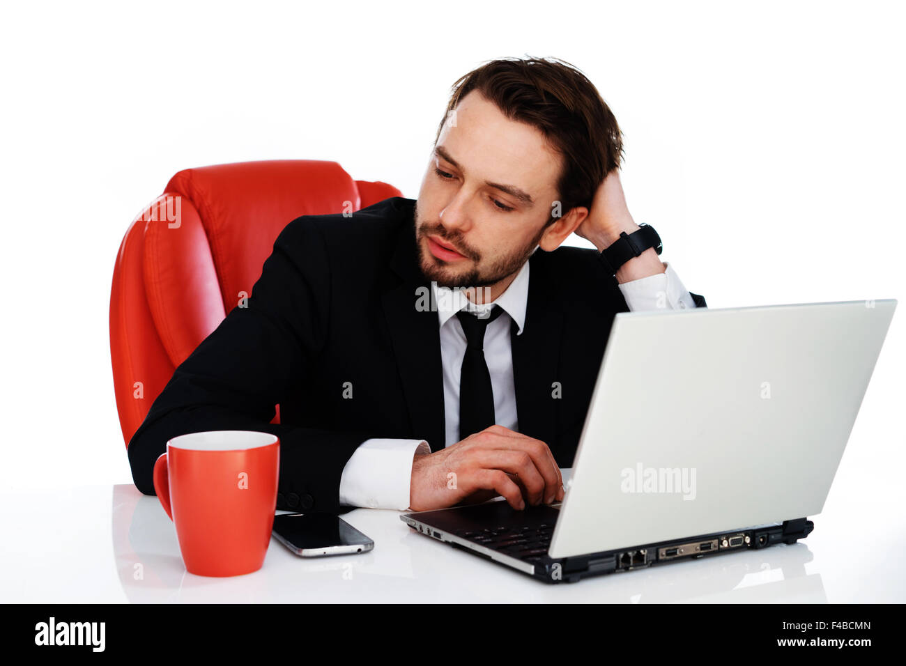 Hardworking businessman pausing to think - Stock Image