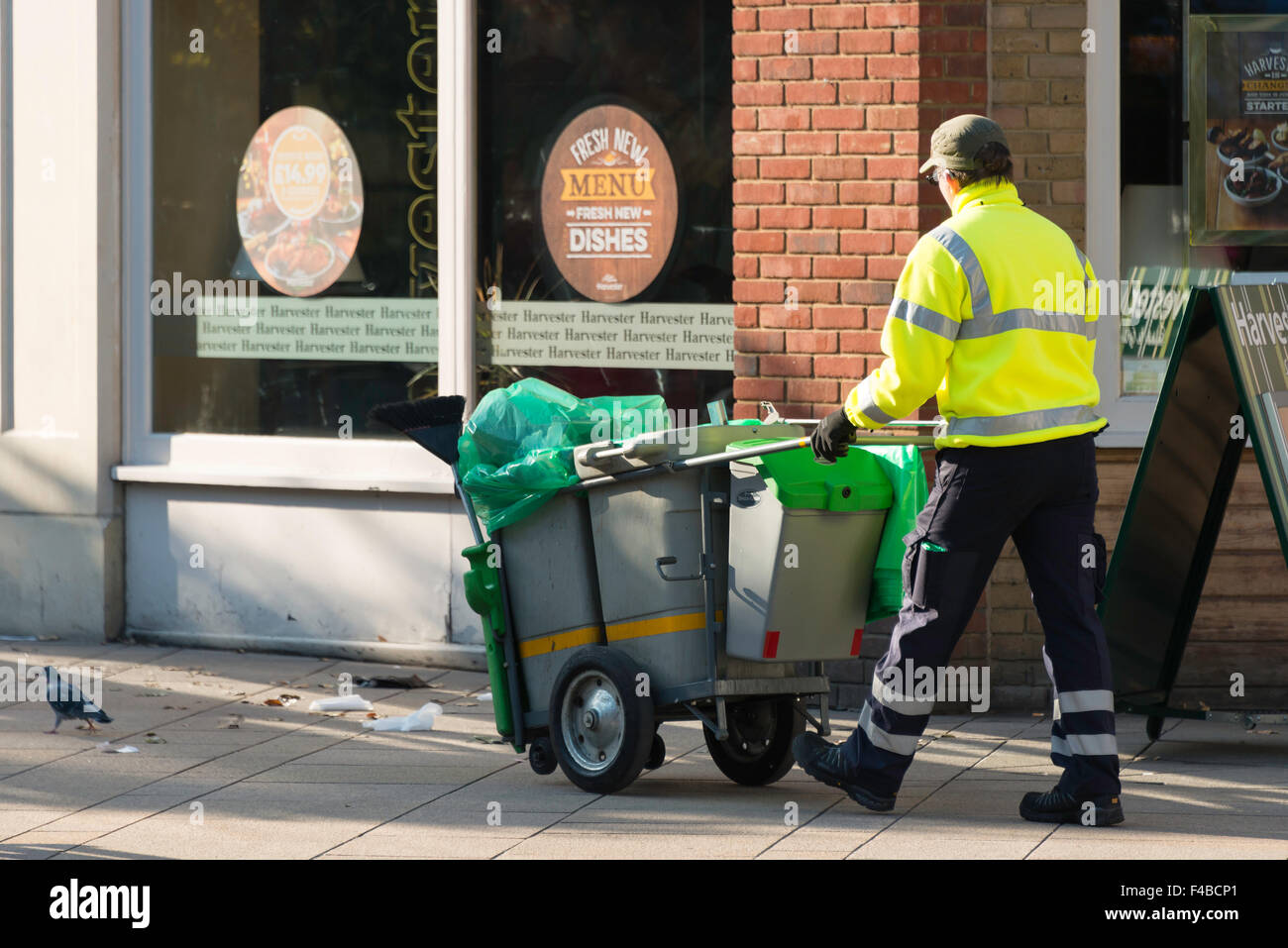 Street cleaner in High Street, Staines-upon-Thames, Surrey, England, United Kingdom Stock Photo
