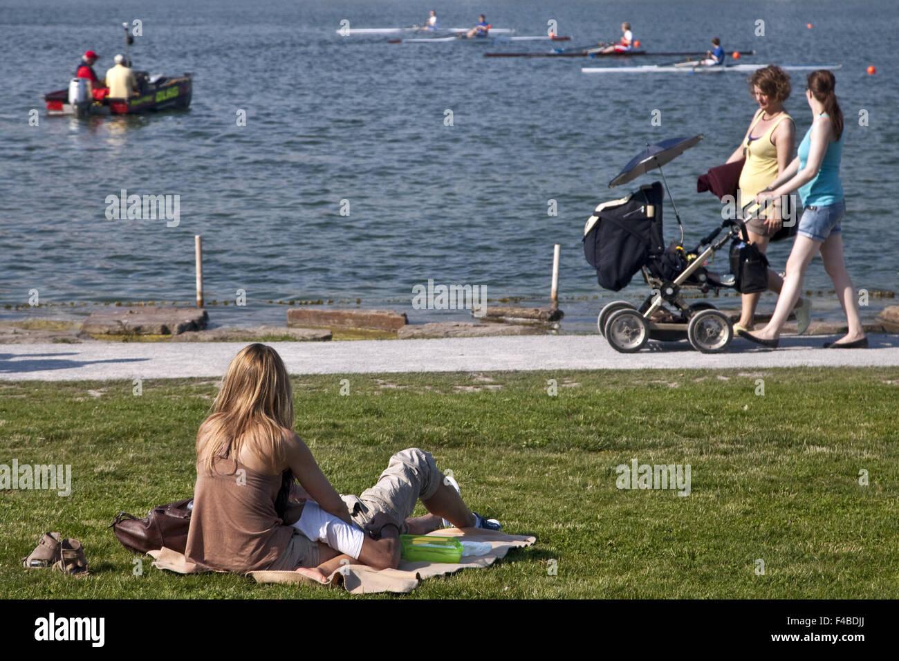 People at Phoenix Lake, Dortmund, Germany. - Stock Image